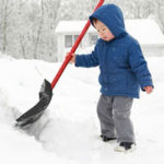 Child with snow shovel