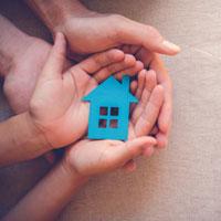 Hands blue house