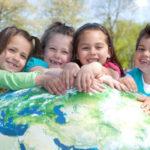 Kids holding earth