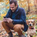Using phone next to dog