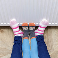 Feet in front of heater